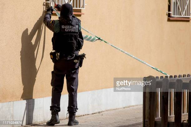 Masked members of the Guardia Civil arrested activists of the pro Catalonia's independence CDR accused of terrorism by the Spanish National High...