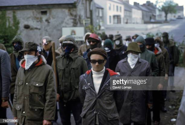Masked members of the loyalist paramilitary organization, the Ulster Defence Association , marching in Belfast, Northern Ireland, June 1972.