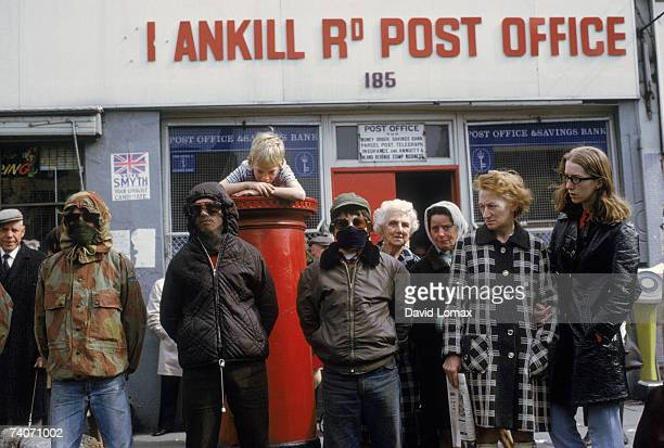 Masked members of the loyalist paramilitary organization the Ulster Defence Association outside the Shankhill Road Post Office in Belfast Northern...
