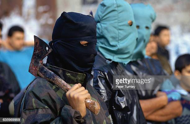 Masked members of the Palestinian Popular Front which advocates withdrawal from IsraeliPalestinian peace negotiations create a threatening presence...