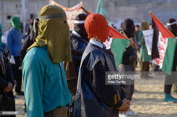Masked members of the Palestinian Popular Front which advocates withdrawal from IsraeliPalestinian peace negotiations gather at a 1993 demonstration...