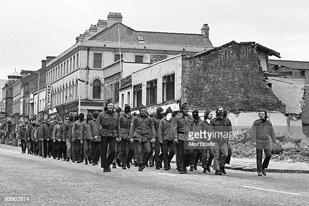 Masked members of the Ulster Defence Association a loyalist paramilitary organisation parade on the Shankill Road Belfast 14th October 1972