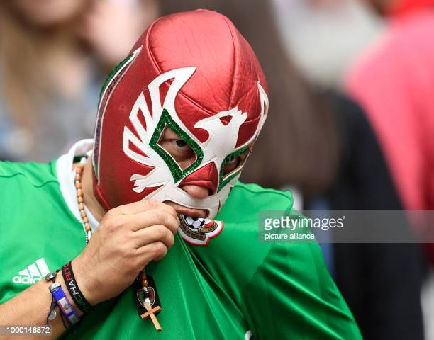 A masked Mexican fan ahead of the group stage match pitting Mexico against Russia at the Kazan Arena in Kazan Russia 24 June 2017 Photo Marius...