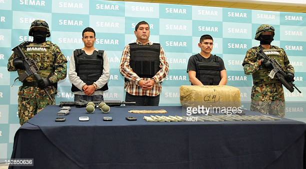 Masked Mexican naval commandos on Thursday September 27 guard three accused gangsters including Ivan Velazquez Caballero a former regional chief of...