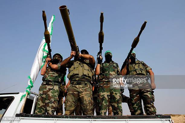 Masked militants of Ezzedine al-Qassam Brigades, Hamas's armed wing, parade in Rafah, southern Gaza Strip, on November 14 during an anti-Israel march...