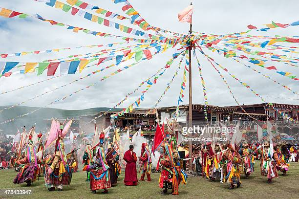 Masked Monks Dancing At A Tibetan Festival