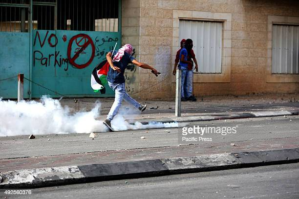 A masked Palestinian demonstrator kicks back a tear gas that was fired by Israeli soldiers in the West Bank city of Bethlehem A 27yearold Palestinian...