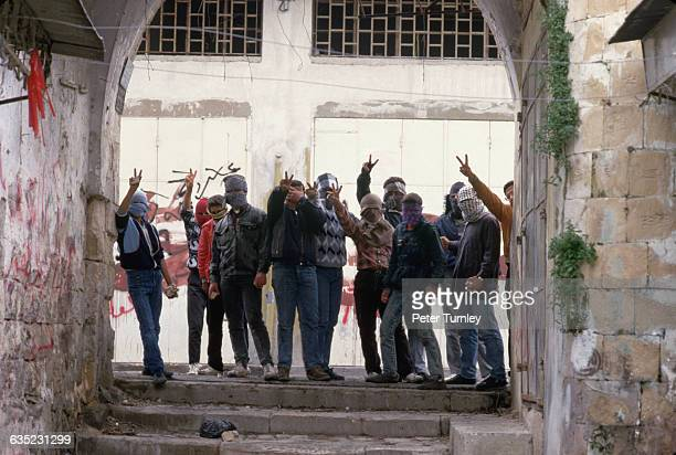 Masked Palestinian Guerrillas Giving Hand Signs