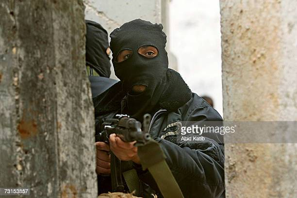 Masked Palestinian gunmen from Fatah guard their position which is in front of the house of Fatah senior leader Sameh AlMadhon on January 30 2007 in...
