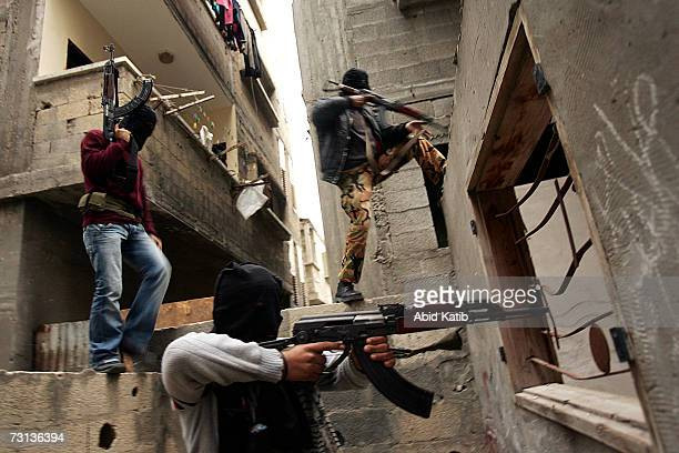 Masked Palestinian gunmen from Fatah take their position during clashes with Hamas members on January 28 2007 in Jabalia in the northern Gaza Strip...