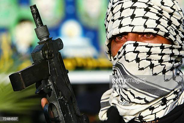 Masked Palestinian gunmen from the Fatah movement march in support of Palestinian leader Yasser Arafat on April 24,2004 in the Nussirat refugee camp,...