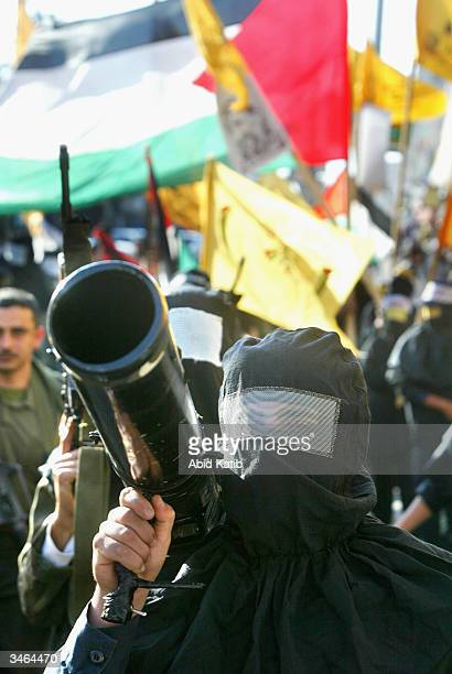Masked Palestinian gunmen from the Fatah movement march in support for Palestinian leader Yasser Arafat on April 242004 in the Nussirat refugee camp...