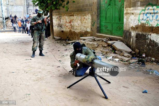 Masked Palestinian Hamas militant prepares a homemade rocket known as AlBattar to use against Israeli tanks during clashes with Israeli forces in the...
