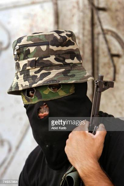 A masked Palestinian member of the Islamic Jihad Movement takes up his position during clashes on June 27 2007 in Gaza City Gaza Strip Israeli forces...