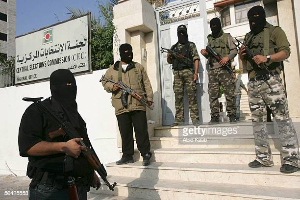 Masked Palestinian Members of the AlAqsa brigade the military wing of the Palestinian president Mahmoud Abbas's Fatah Movement hold their guns as...