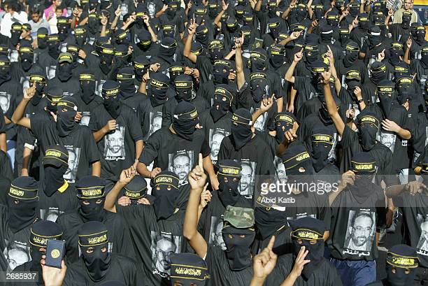 Masked Palestinian members of the Islamic Jihad Movement march during a rally October 31 2003 in Beit Lahiya in north Gaza About 3000 supporters held...