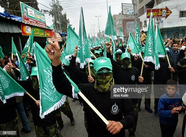 Masked Palestinian members of the Islamist Hamas movement march during a demonstration in the southern Gaza Strip refugee camp of Rafah December 14...