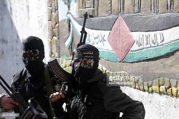 Masked Palestinian militants from the alAqsa Martyrs Brigades a group linked to the Fatah movement attend the funeral of Mussa Abu Zuaiter a...