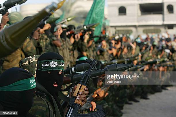 Masked Palestinian militants from the military wing of the Hamas movement participate in celebrations for the Israeli pullout from Gaza on August 24...