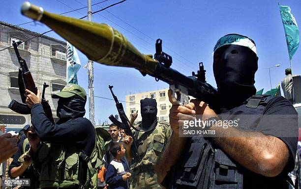 Masked Palestinian militants parade holding their rifles and Rocket Propelled Grenade launchers during the funeral of Bilal Hamdan 23 and Jamil Abu...