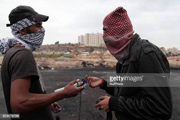 Masked Palestinian protesters prepare to throw molotov cocktail on Israeli troops during clashes near Beit El settlement west bank Clashes erupted...