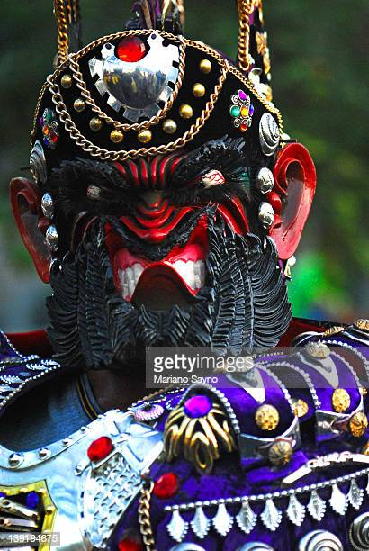 masked participant in sto. niño festival - sinulog festival stock photos and pictures