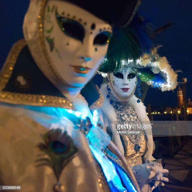 Masked people on Shiavoni quay
