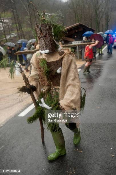 Masked people perform during the celebration of an ancient traditional carnival on January 29 2019 in Zubieta Spain The Joaldunak or Bellringer is a...