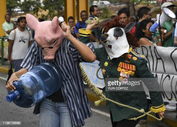 TOPSHOT Masked people protest water shortage during the Earth Day at Las Mercedes neighborhood in Caracas on April 22 2019