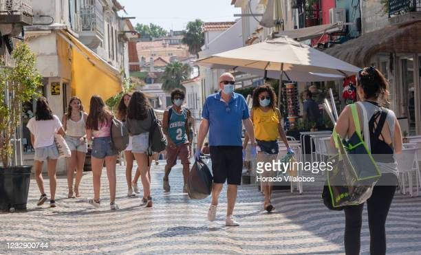 Masked people walk on the pedestrian Rua Frederico Arouca during the COVID19 Coronavirus pandemic on May 29 2020 in Cascais Portugal The country is...