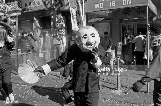 A masked performer dances for prosperity and good luck during the annual Chinese New Year celebrations on Mott Street in the Chinatown neighborhood...