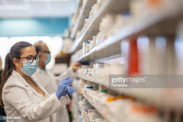 masked pharmacist - drug stock pictures, royalty-free photos & images