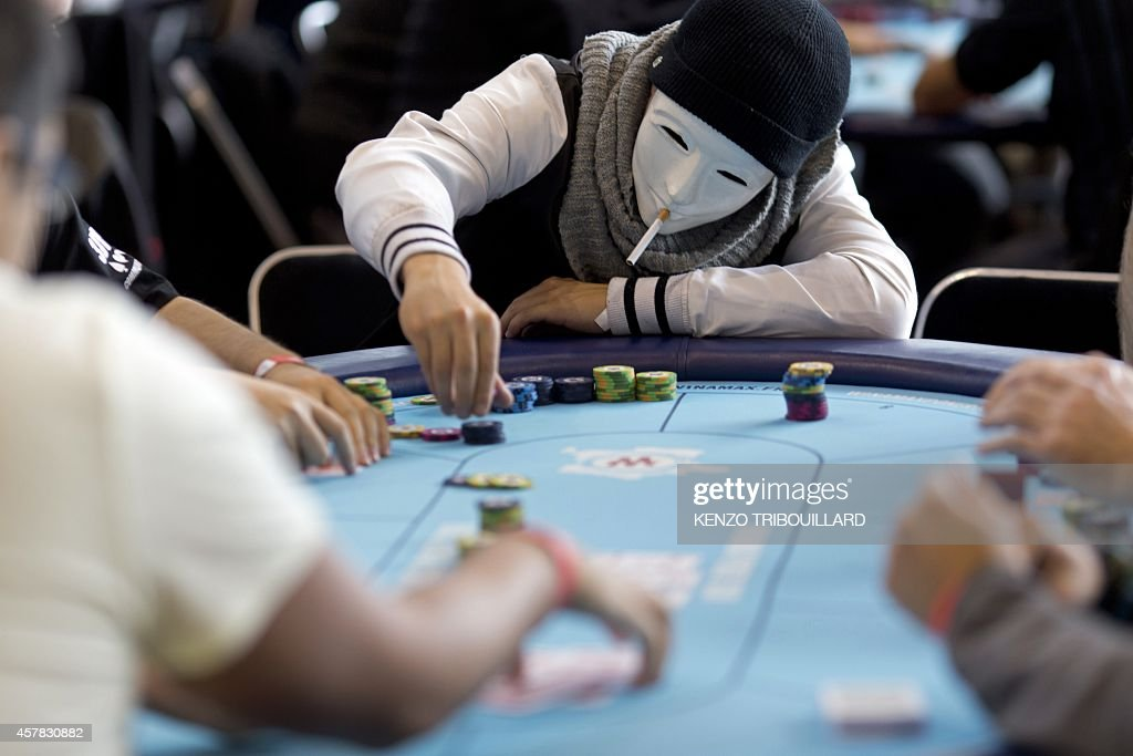 A Masked Player Places Chips On The Table During The Launch Of The News Photo Getty Images