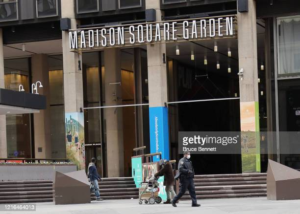 A masked police officer makes his way past Madison Square Garden on April 02 2020 in New York City Currently over 92000 people in New York state have...