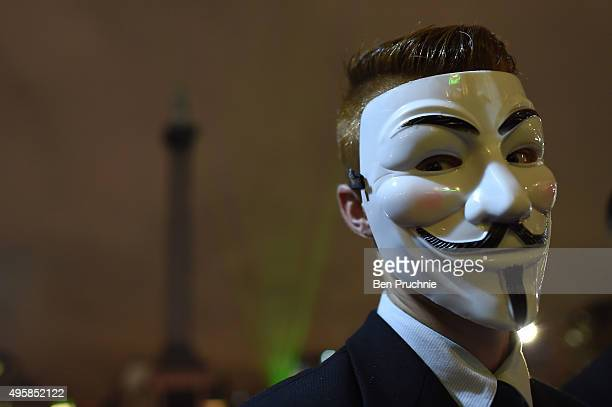 A masked protester looks at the camera during the Million Mask March in Trafalgar Square on November 5 2015 in London England The annual...