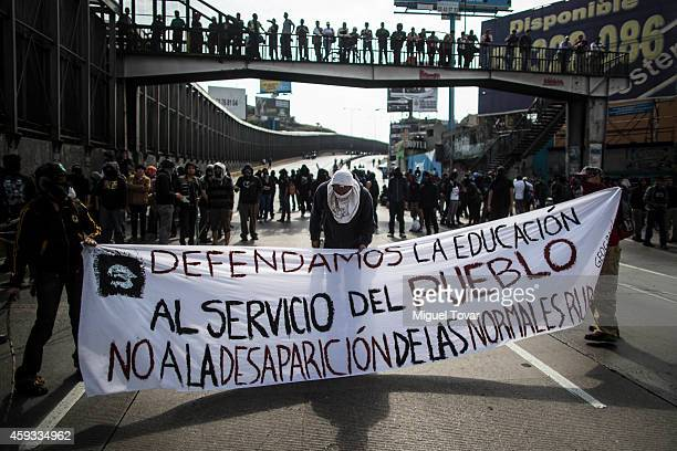 Masked protesters block airport boulevard during a demonstration against Mexican president Enrique Pena Nieto and his government after announcing...