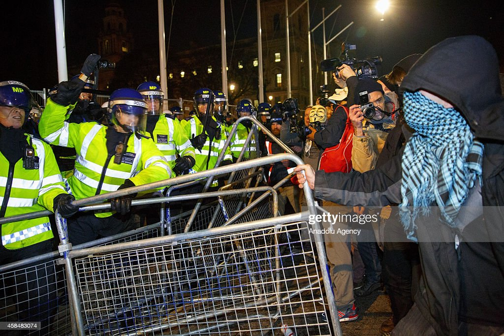 Masked protesters clashing with police during the 'Million Mask March' demonstration organised by activists Anonymous in London, England on November 5, 2014. The event has become associated with protesters donning the Guy Fawkes mask made famous by graphic novel and film of 'V for Vendetta' and now used around the world as a symbol of anarchy.
