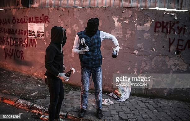 Masked protesters hold petrol bombs during clashes with Turkish police using water cannons and tear gas to disperse a demonstration in Istanbul...