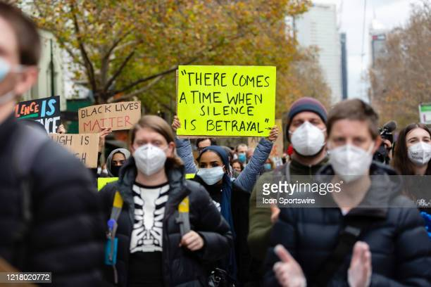 Masked protesters holding placards march through the CBD during a Black Lives Mater rally on 06 June, 2020 in Melbourne, Australia. This event was...