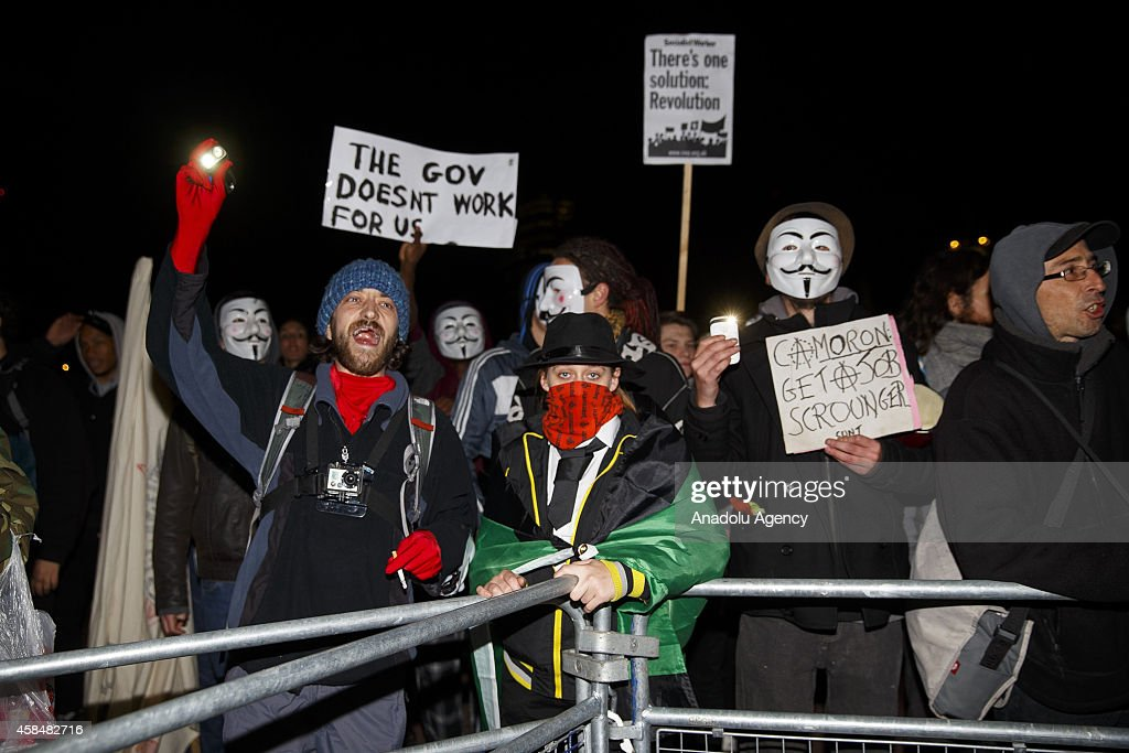 Masked protesters taking part at the 'Million Mask March' demonstration organised by activists Anonymous outside Buckingham Palace in London, England on November 5, 2014. The event has become associated with protesters donning the Guy Fawkes mask made famous by graphic novel and film of 'V for Vendetta' and now used around the world as a symbol of anarchy.
