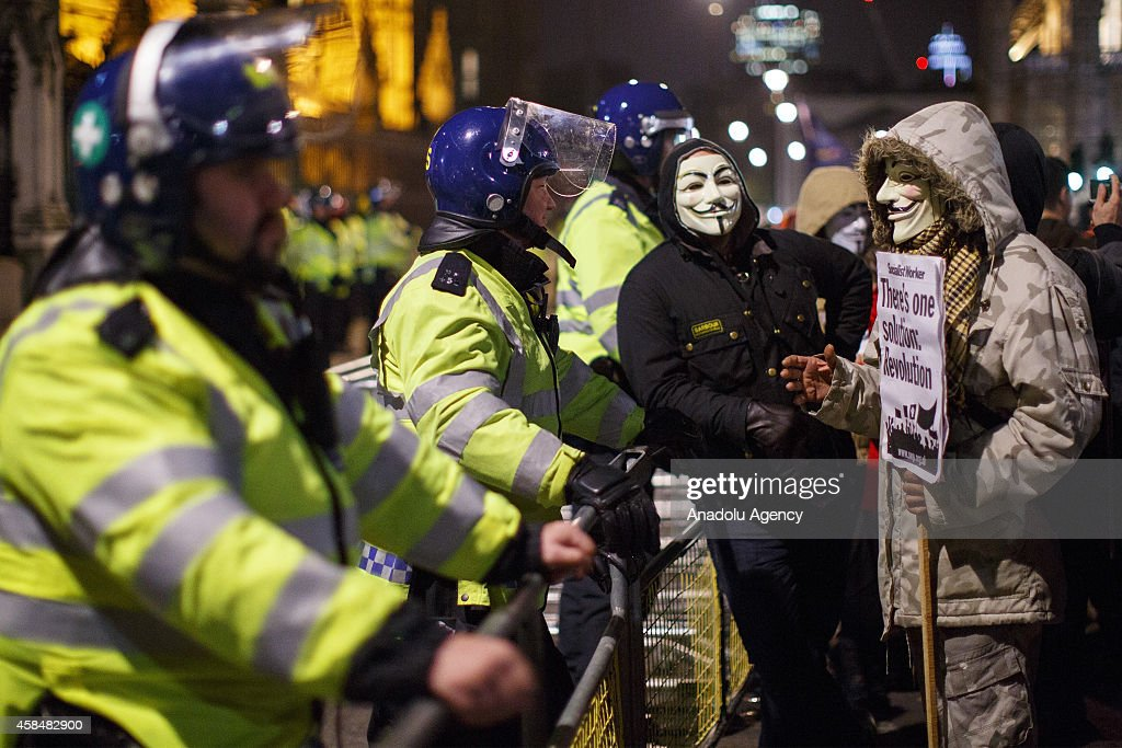 Masked protesters taking part at the 'Million Mask March' demonstration organised by activists Anonymous in London, England on November 5, 2014. The event has become associated with protesters donning the Guy Fawkes mask made famous by graphic novel and film of 'V for Vendetta' and now used around the world as a symbol of anarchy.