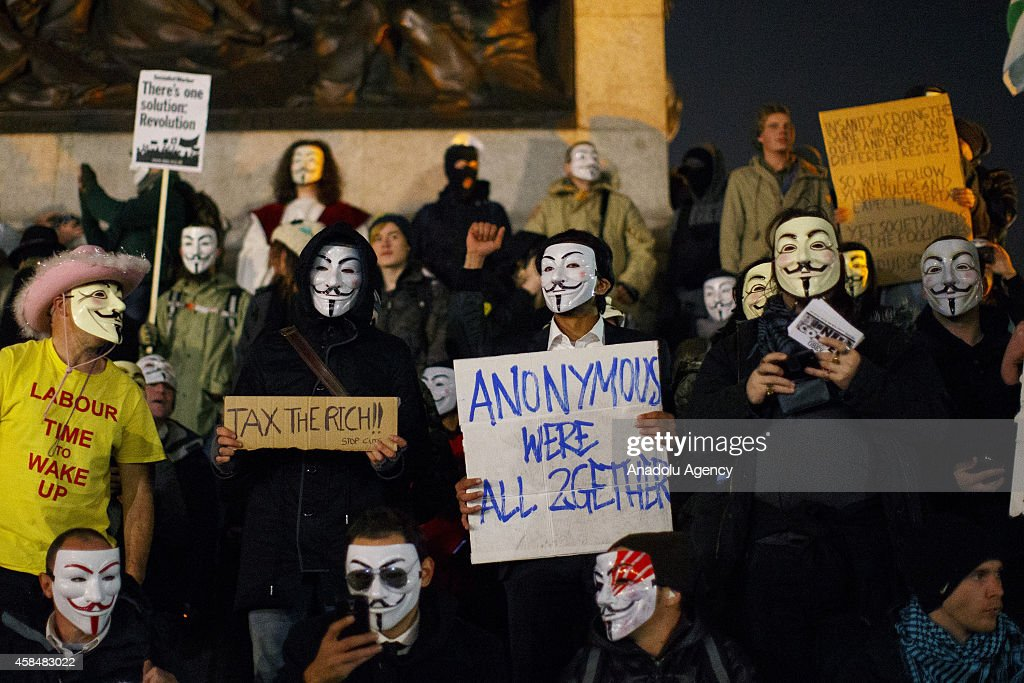 Masked protesters taking part at the 'Million Mask March' demonstration organised by activists Anonymous at Traflagar Square in London, England on November 5, 2014. The event has become associated with protesters donning the Guy Fawkes mask made famous by graphic novel and film of 'V for Vendetta' and now used around the world as a symbol of anarchy.