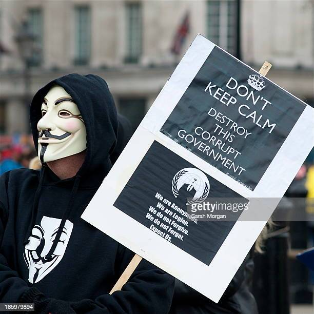 Masked protestor at Trafalgar Square protest against the 'bedroom tax' changes to Housing Benefits payments. March 30th 2013.