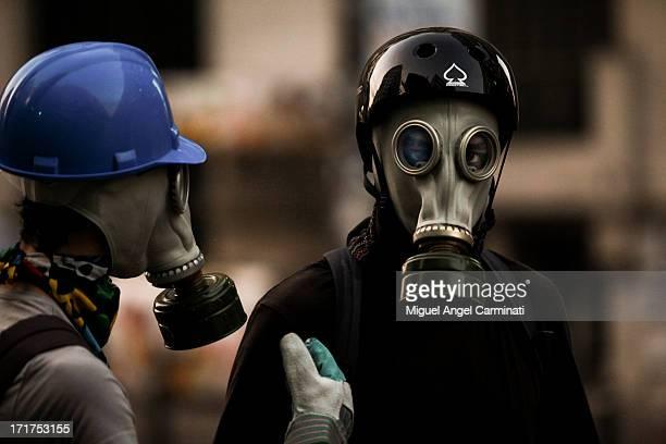 Masked protestor looking at the camera.