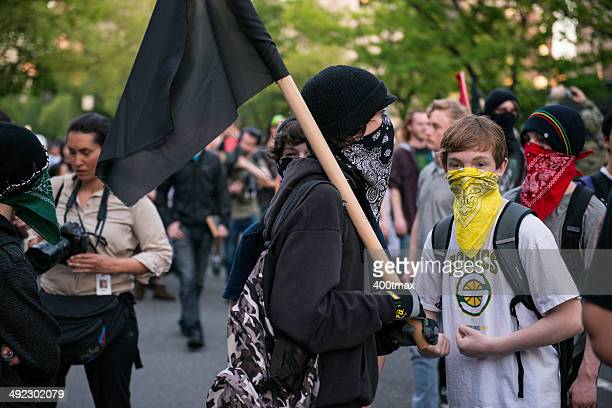 masked protestors - may day international workers day stockfoto's en -beelden