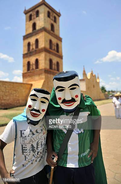 Masked residents pose after performing Los Abuelos traditional dance for Queen Sofia of Spain in San Jose de Chiquitos Santa Cruz department Bolivia...