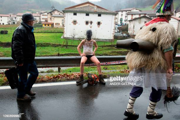 A masked reveller attends celebrations of the ancient carnival of Zubieta in the northern Spanish Navarra province on January 29 2019 The yearly...