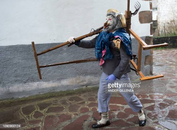A masked reveller takes part in celebrations of the ancient carnival of Zubieta in the northern Spanish Navarra province on January 29 2019 The...