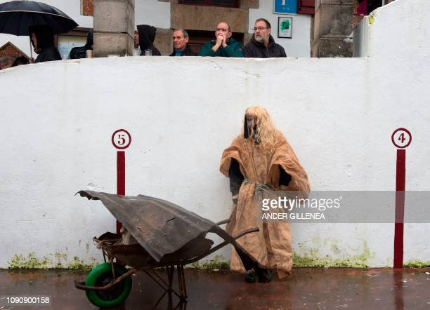 TOPSHOT A masked reveller takes part in celebrations of the ancient carnival of Zubieta in the northern Spanish Navarra province on January 29 2019...