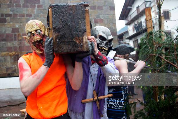 Masked revellers carry a mock coffin during celebrations of the ancient carnival of Zubieta in the northern Spanish Navarra province on January 29...